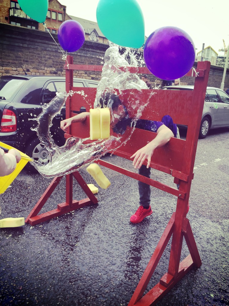 Our lettings negotiator Bradley bravely took to the stocks and let an audience throw ice-cold water soaked sponges at him for a small donation