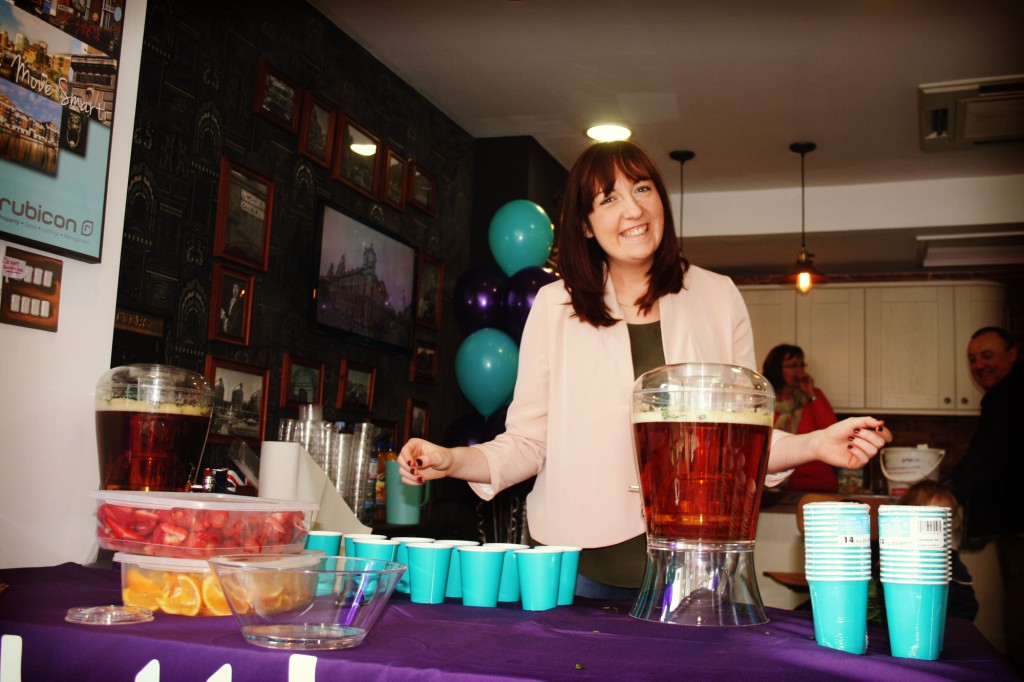 Our admin girl Vicky serving up fresh fruit & Pimms